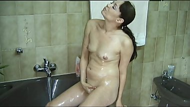 6-movies.com - Stepmom MILF plays with her pussy in bathroom