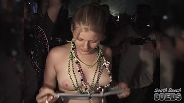 back stage girls flashing at a music festival