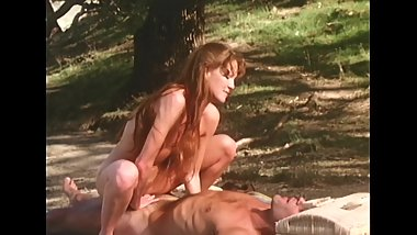 Young redhead fucks a stranger outdoors