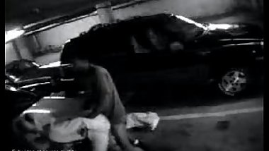 Security camera in parking lot catches couple having sex