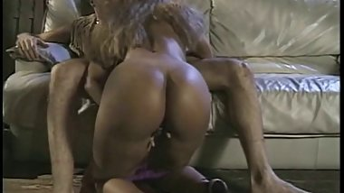 Sexy girl on the sofa  gives a big cock a good sucking