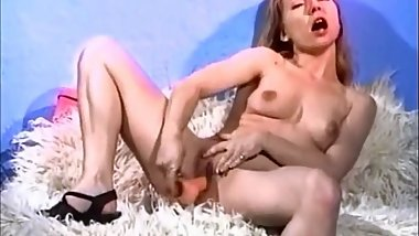 Cute blonde plays with her shaved pussy