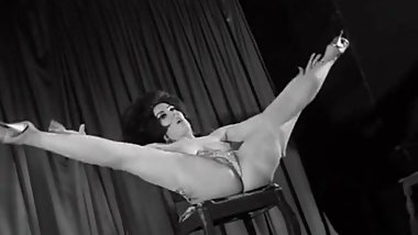 Vintage Stripper Dancing on a Stage (1960s Retro)